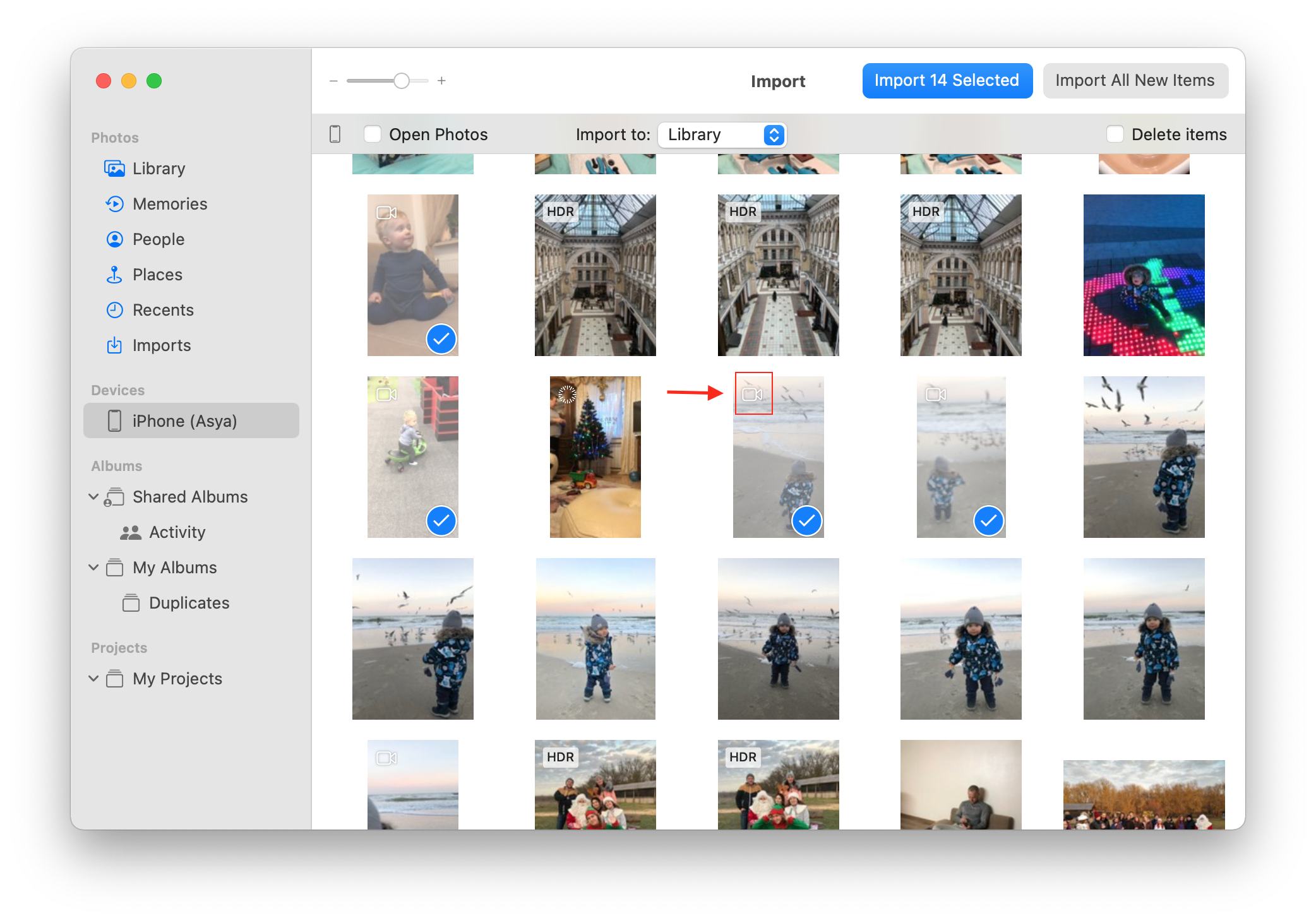 Photos app window showing selected videos for importing
